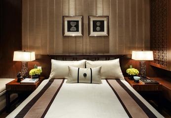 新中式卧室背景墙装修效果图 低调奢华